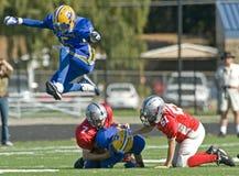 Lucht van de Voetbal van de jeugd de Amerikaanse Stock Foto's