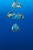 Luchtbellen onderwater Stock Afbeelding