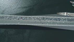 Luchthommelmening van de Gouden Brug van Zolotoy Kabel-gebleven brug over Zolotoy Rog Golden Horn in Vladivostok stock video