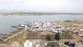 Luchtmening van behandelings van afvalwaterinstallatie en scheepswerf in Olhao, Portugal stock video