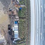 Luchtmening van de materiële opslag voor kanaalbouwwerkzaamheid  Stock Afbeelding