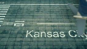 Luchtmening van een vliegtuig die aan de luchthaven van Kansas City aankomen Reis naar het 3D teruggeven van Verenigde Staten Stock Foto