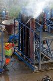 Luchtmening van werkende bouwvakker Stock Foto's