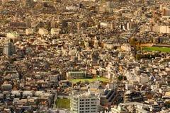 Luchtmeningstokyo overvolle woonplaats de stad in Stock Afbeelding