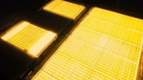 Luchtoverzicht van lichtgevende serres stock footage