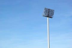 Luci alte dello stadio con il cielo Fotografia Stock