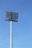 Luci alte dello stadio con il cielo Immagine Stock