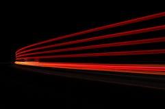 Luci astratte dell'automobile in rosso ed in arancio Fotografia Stock