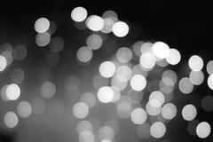 Luci astratte monocromatiche di illuminazione di inverno della sfuocatura Immagini Stock Libere da Diritti