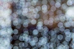 Luci bianche della sfuocatura, struttura astratta dei punti defocused immagine stock libera da diritti