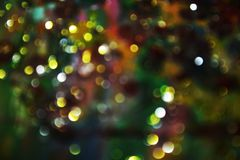 Luci circolari blu dorate vaghe nelle tonalità variopinte pastelli, fondo, bokeh Fotografia Stock