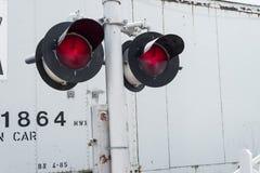 Luci d'avvertimento dell'incrocio di ferrovia Fotografia Stock
