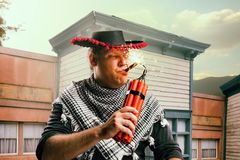 Luci del cowboy un sigaro da un bastone di dinamite fotografie stock libere da diritti