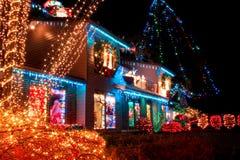 Luci del villaggio di Natale Fotografia Stock