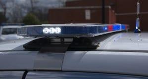 Luci del volante della polizia su un veicolo di emergenza Fotografie Stock