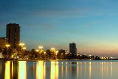 Luci della città nel tramonto Fotografia Stock
