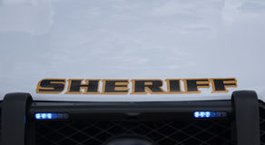 Luci della griglia su un veicolo contrassegnato dello sceriffo Immagine Stock