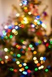 Luci di natale astratte sull'albero a casa Fotografia Stock Libera da Diritti
