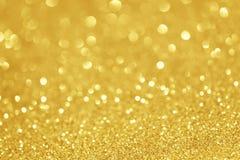 Luci di natale brillanti dell'oro Priorità bassa astratta vaga Immagine Stock