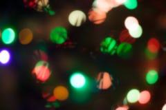 Luci di Natale, fondo unfocused Fotografie Stock