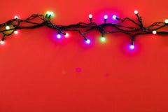 Luci di Natale su fondo blu fotografie stock