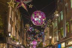 Luci di Natale sulla via di Carnaby, Londra Immagine Stock