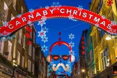 Luci di Natale sulla via di Carnaby, Londra Regno Unito Fotografie Stock Libere da Diritti