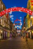 Luci di Natale sulla via di Carnaby, Londra Regno Unito Immagine Stock Libera da Diritti