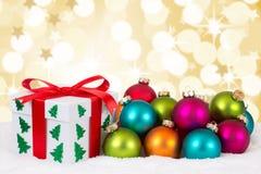 Luci dorate del fondo della decorazione della carta di regalo di Natale Immagini Stock Libere da Diritti