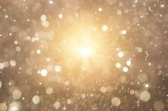 Luci dorate fondo di scintillio, luci di natale e stelle astratte di lampeggiamento Fotografia Stock