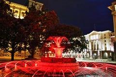 Luci rosse quadrate Sofia Bulgaria di notte Fotografia Stock