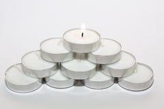 Luci rotonde della candela sistemate Fotografie Stock