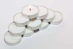 Luci rotonde della candela sistemate Fotografia Stock