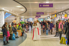 Lucia celebration in Sweden. Norrkoping, Sweden - December 13, 2015: Lucia celebration in a mall in Norrkoping. The celebration of Lucia or Saint Lucy is one of Stock Photography