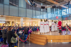 Lucia celebration in Sweden. Norrkoping, Sweden - December 13, 2015: Lucia celebration in a mall in Norrkoping. The celebration of Lucia or Saint Lucy is one of Stock Photos
