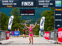 Luciana Cox of Brazil finishing 20.8 mile stage 1. Buena Vista, CO - Aug 21: Luciana cox of Brazil finishes the 20.8 mile stage 1 race of the Run3 Gore-Tex Royalty Free Stock Image