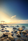 Lucid silky sea with many rocks. At sunset royalty free stock photo