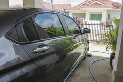Lucidi sull'automobile nera Fotografia Stock Libera da Diritti