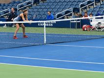 Lucie Safarova - US Open Tennis. Lucie Safarova at the net during a Women`s doubles match in 2017 on the new Grandstand Court at the US Open Tennis Championship Stock Photos