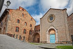 Lucignano, Arezzo, Tuscany, Italy: the medieval church of San Francesco and the ancient town hall royalty free stock image