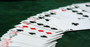 Luck. Cards on green casino table Stock Photo