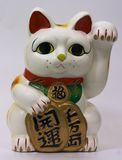 Luck Cat Front. Isolated ceramic luck cat stock images