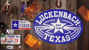 Luckenbach, Texas Sign and Memorabilia on Side of Wooden Barn. Luckenbach, Texas sign and memorabilia on the side of a wooden barn Royalty Free Stock Image