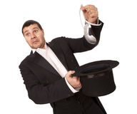 Luckless magician taking out computer mouse Royalty Free Stock Images