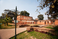 LUCKNOW, INDIA: Old red buildings of Lucknow Residency at sunny day Stock Photos