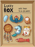 Lucky amulets and happy symbols collection in a cardboard box Royalty Free Stock Image