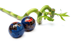 Lucky bamboo and zen balls Royalty Free Stock Image