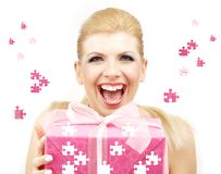 Lucky blonde with puzzle gift box Royalty Free Stock Photo