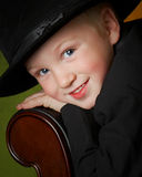 Lucky Boy. Little boy portrait in top hat Royalty Free Stock Photography