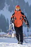 Lucky boy  snowboarder in a mountain valley Royalty Free Stock Images